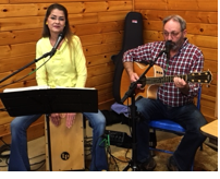 "Kelsi and Gary Stacken of ""From the Heart"" providing music at the Ideal Green Market Cooperative indoor farmer's and crafter's market"